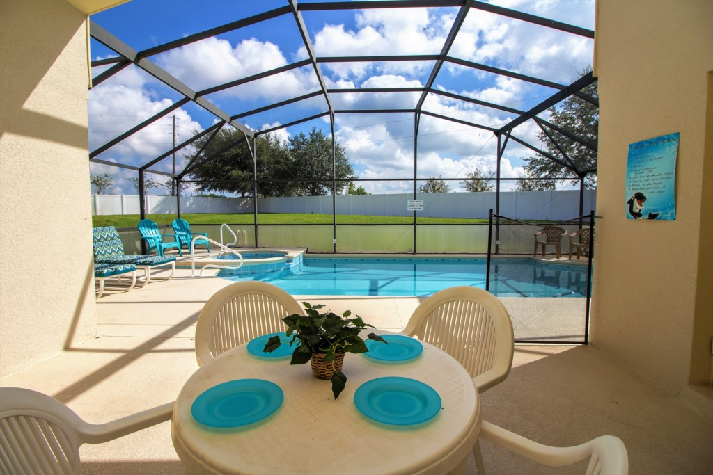 27-The lanai area has a table for four overlooking th pool and spa.jpg