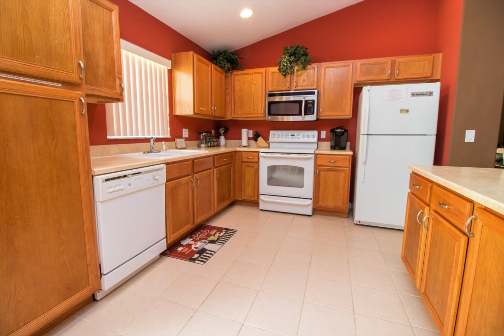 6-The kitchen has an island with plentiful work space.jpg