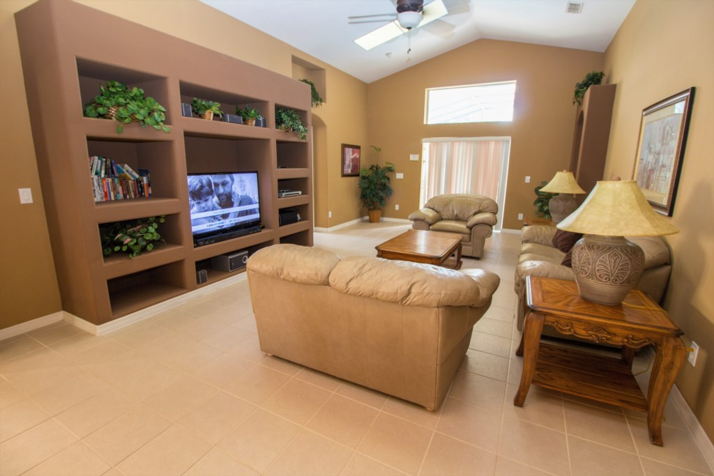 8-The living room area has built in shelving and flatscreen cable TV.jpg