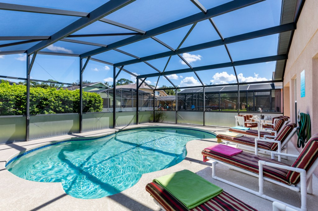 Spacious pool deck with plenty of sun loungers