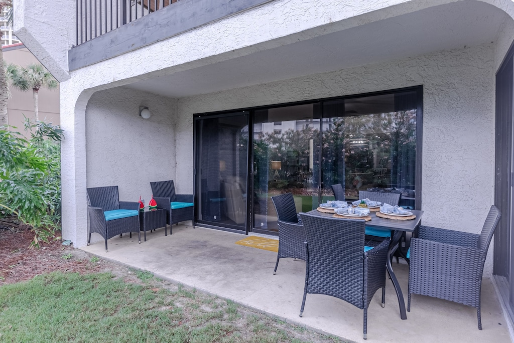 Back patio  - offers plenty of seating.