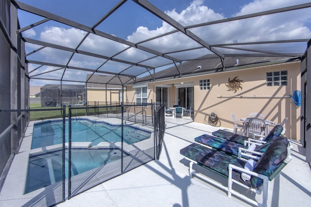 Pool area with child safety fence and spillover spa