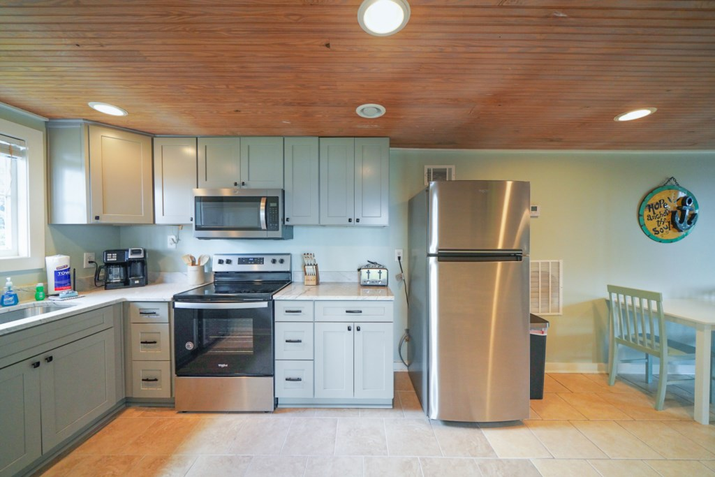 All stainless appliances and beautiful stone countertops