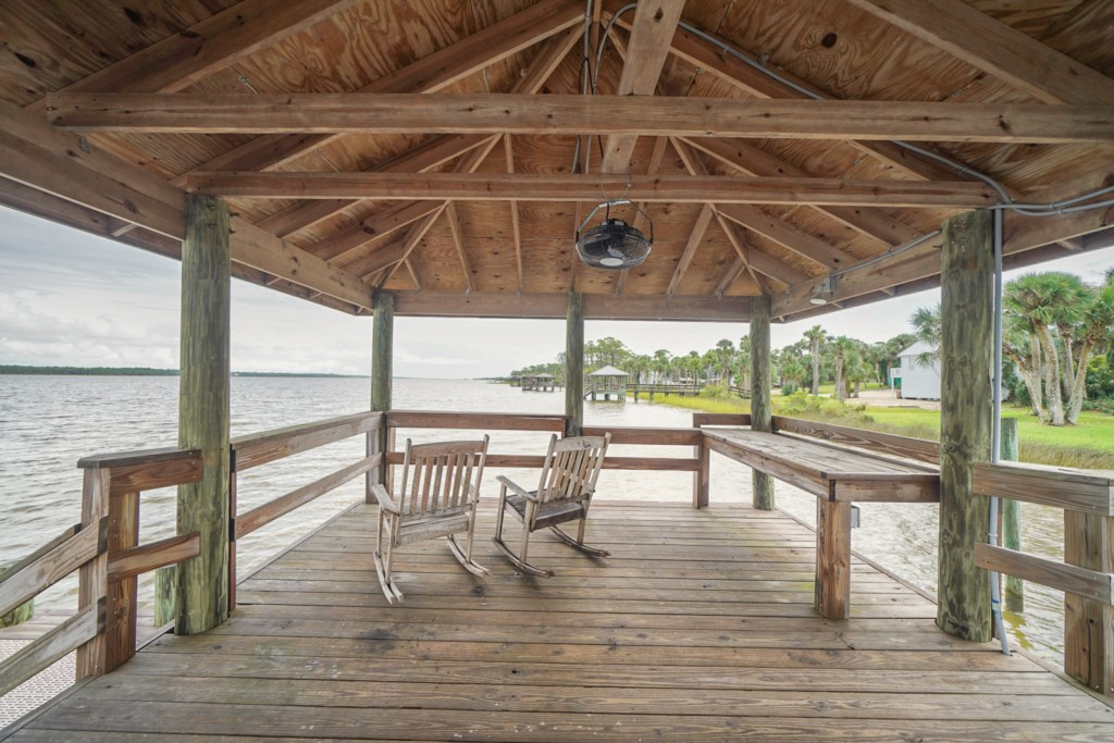 Enjoy morning coffee or catch your dinner off the shared dock