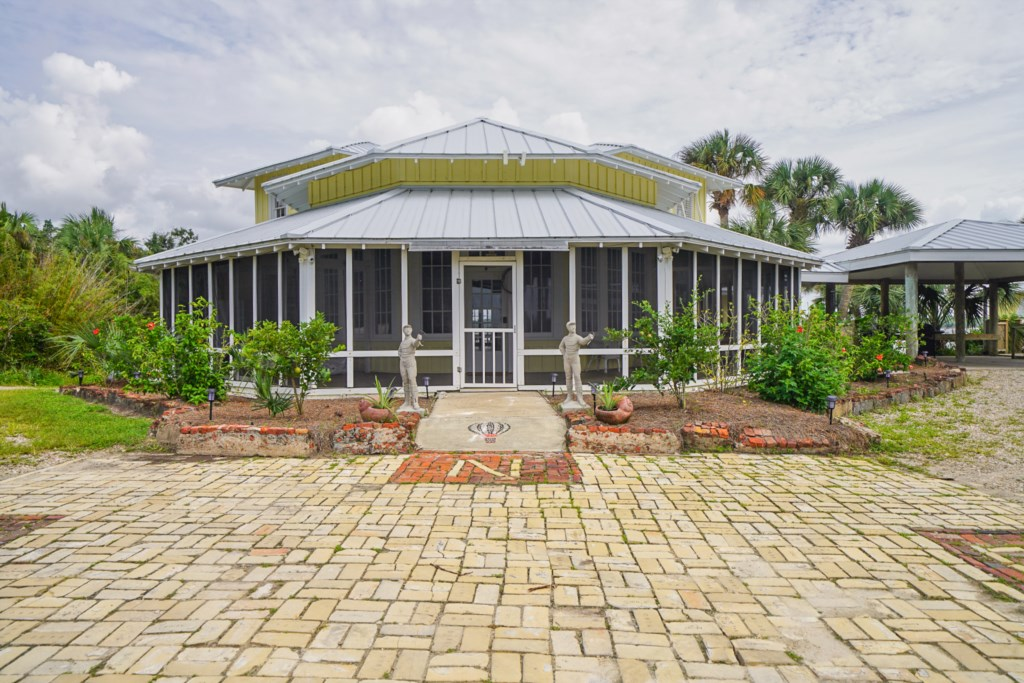 Shared amenities include a shallow water dock, game room with pool table and indoor heated pool & easy beach access