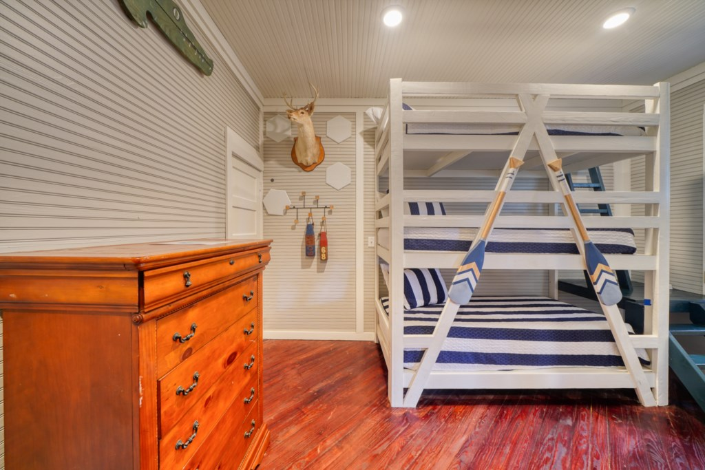 1st floor bunk room with 6 twin xl beds and attached bath