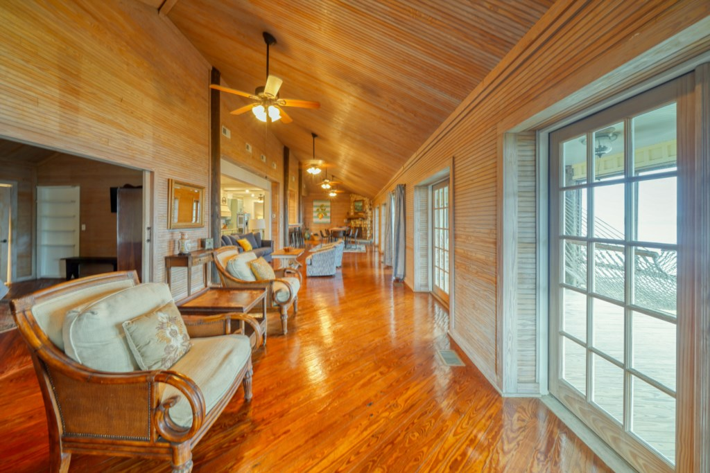 This large living area is adjacent to the screened in porch overlooking Indian Pass Lagoon