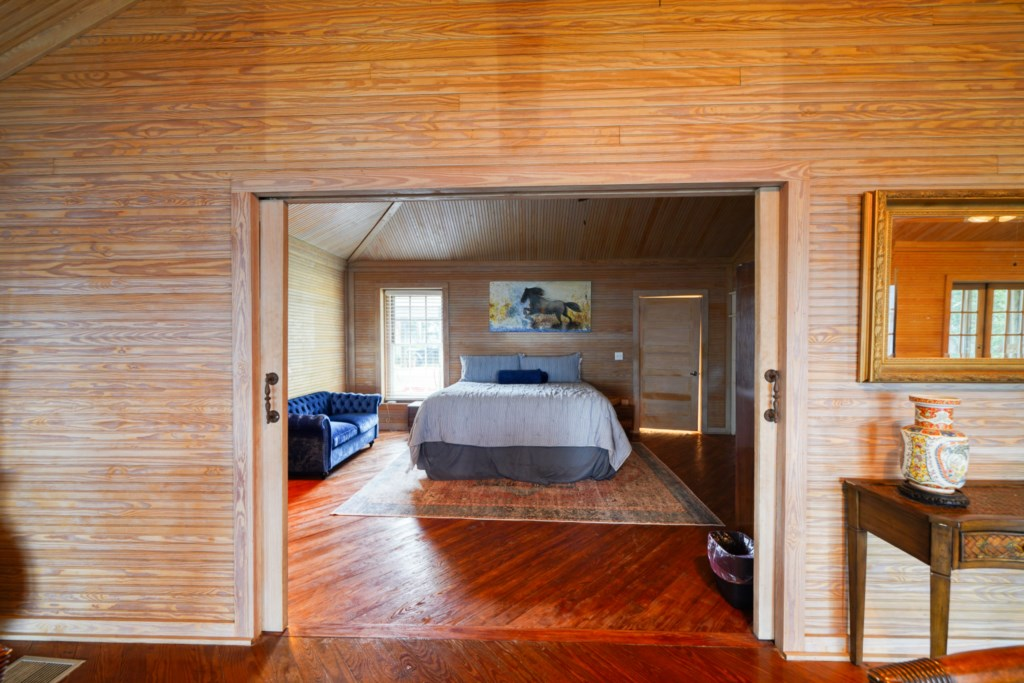 King bedroom with pocket doors for privacy