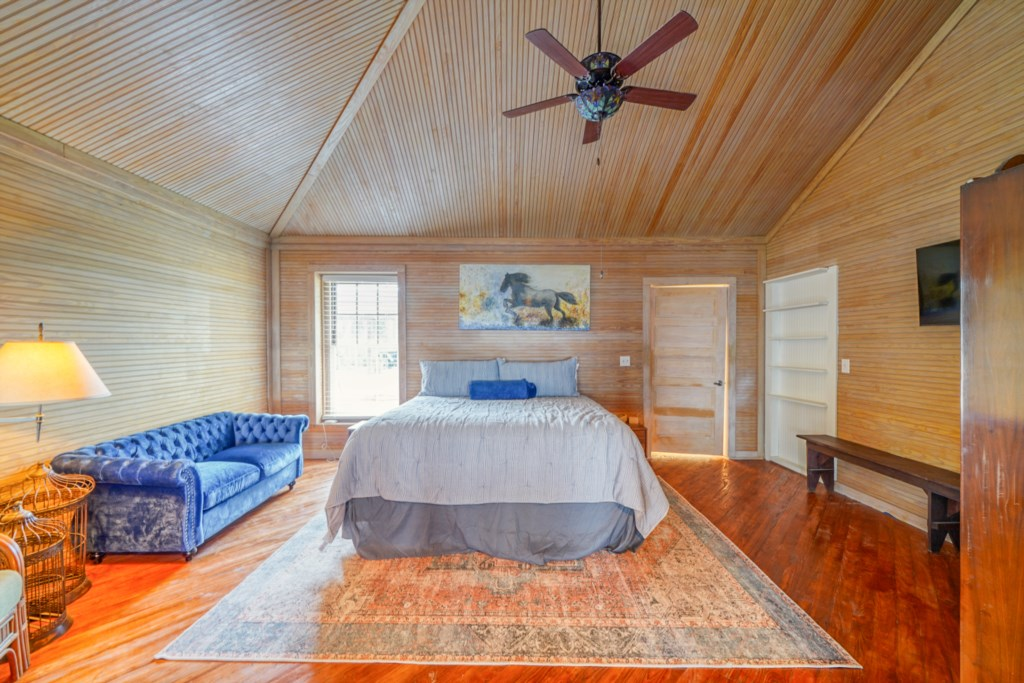 Large king guest room with attached bath and flat screen television