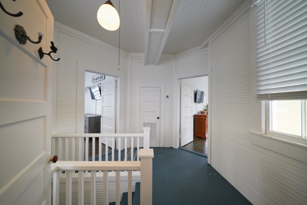 The second floor features two queen guest bedrooms with shared bath