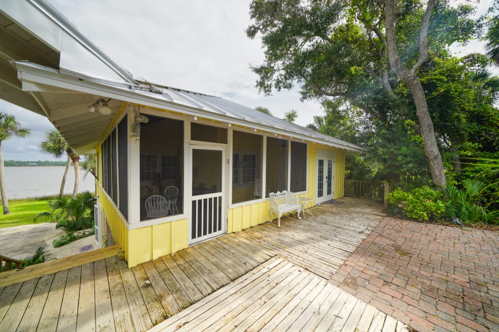 Enjoy a private screened in porch for alfresco dining options