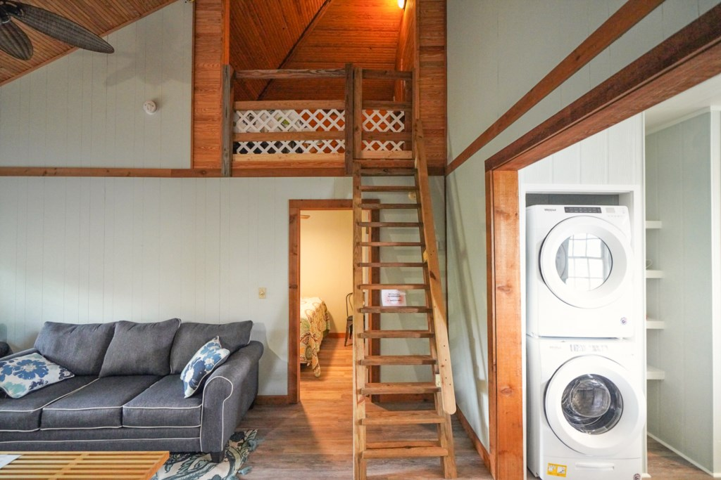 The upstairs loft accommodates two with twin beds