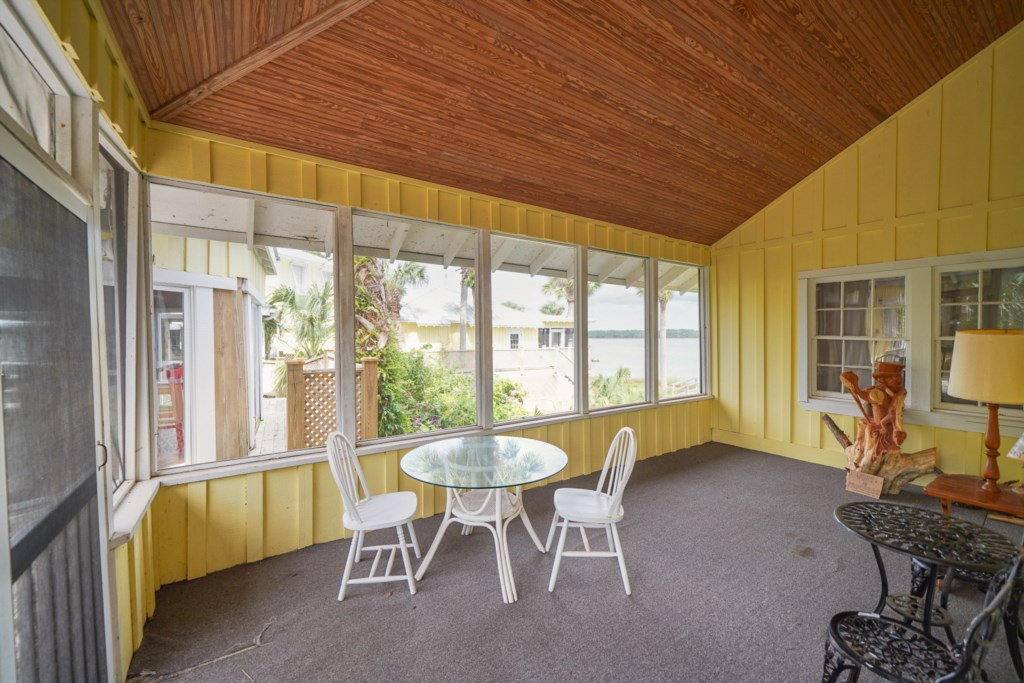 Large screened in porch  overlooking a serene garden space