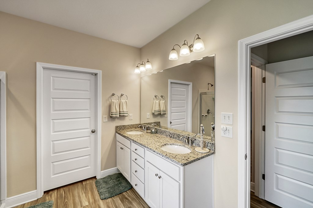 Attached master bathroom with double vanity