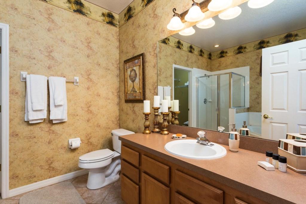 Master suite 1 bathroom with garden tub & glass door shower