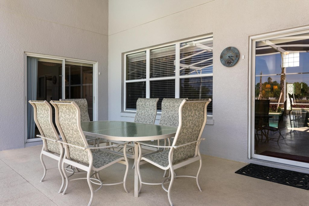 Enjoy a casual outdoor meal in the shade of the covered lanai