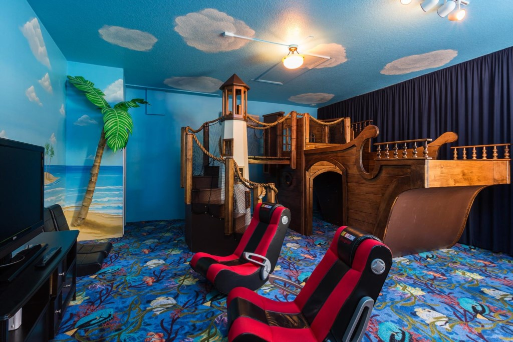 Kids will love the pirate-themed game room with pirate ship play center and 42-inch TV
