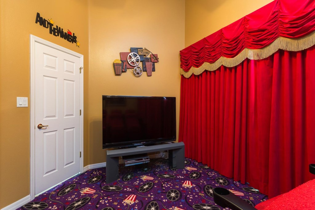 Watch movies in the home theater with 65-inch TV