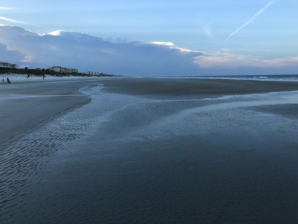 The wide sandy beach at low tide