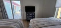 Flat screen tv located in second bedroom