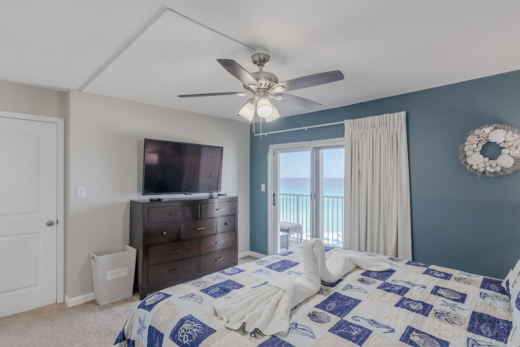 Wall mounted tv - and balcony access of master bedroom.