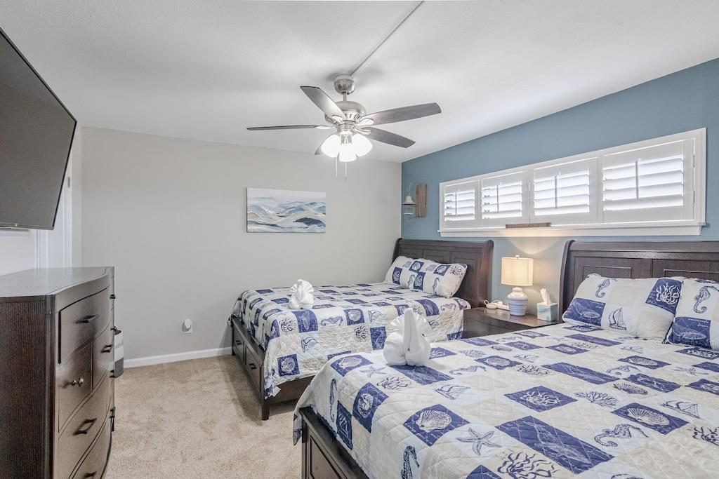 Bedroom 2 offers 2 Queen Beds & wall mounted tv