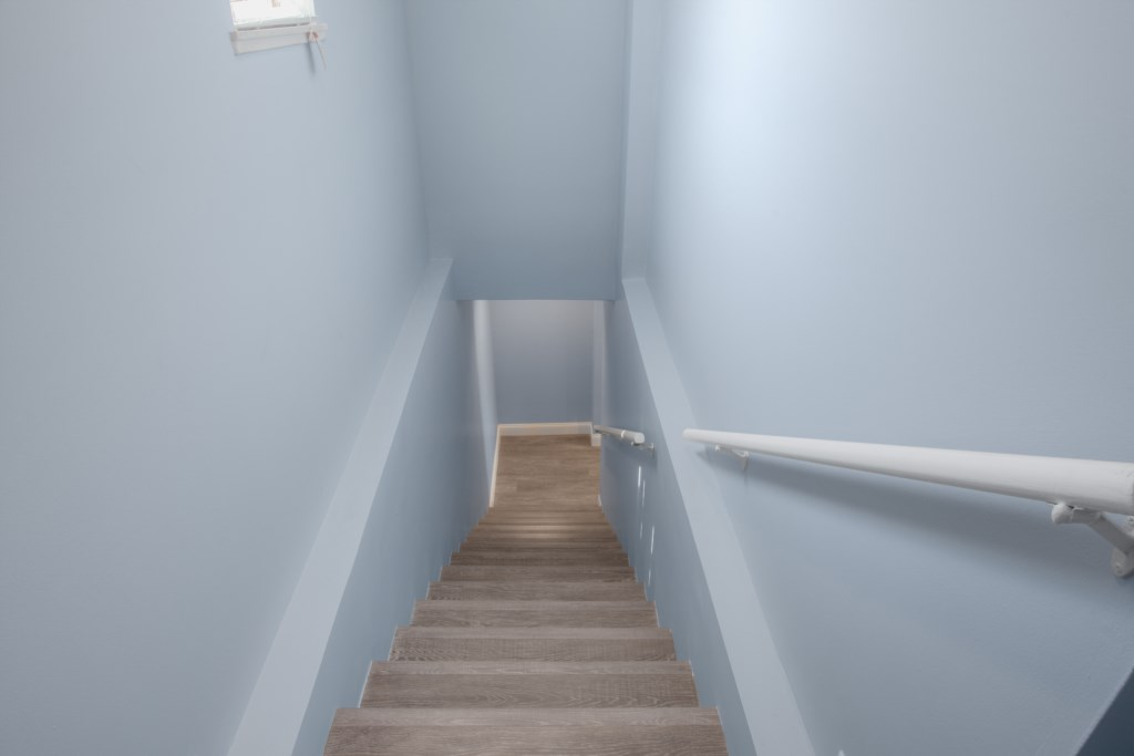 Stairs that Lead from Upstair Bedrooms to Downstairs Livingroom and Kitchen