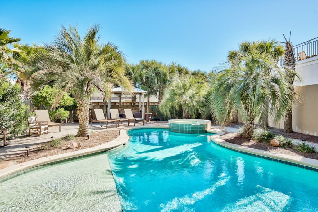 Renew your senses in the 30ft x 19ft Private Lagoon Pool surrounded by Palm Trees