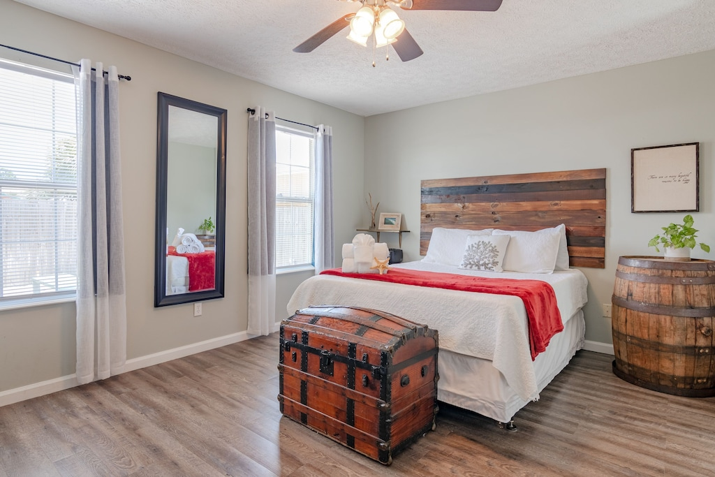Private Master Suite offers a queen bed &  private bath w/ shower.