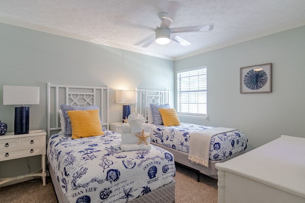 Bedroom 2 offers 2 twin beds, 50 inch wall mounted tv, attached full bath