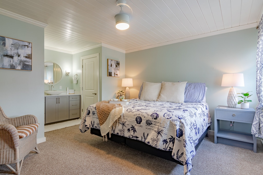 Master Suite offers a King Bed, private en suite bath & wall mounted 50 inch tv.