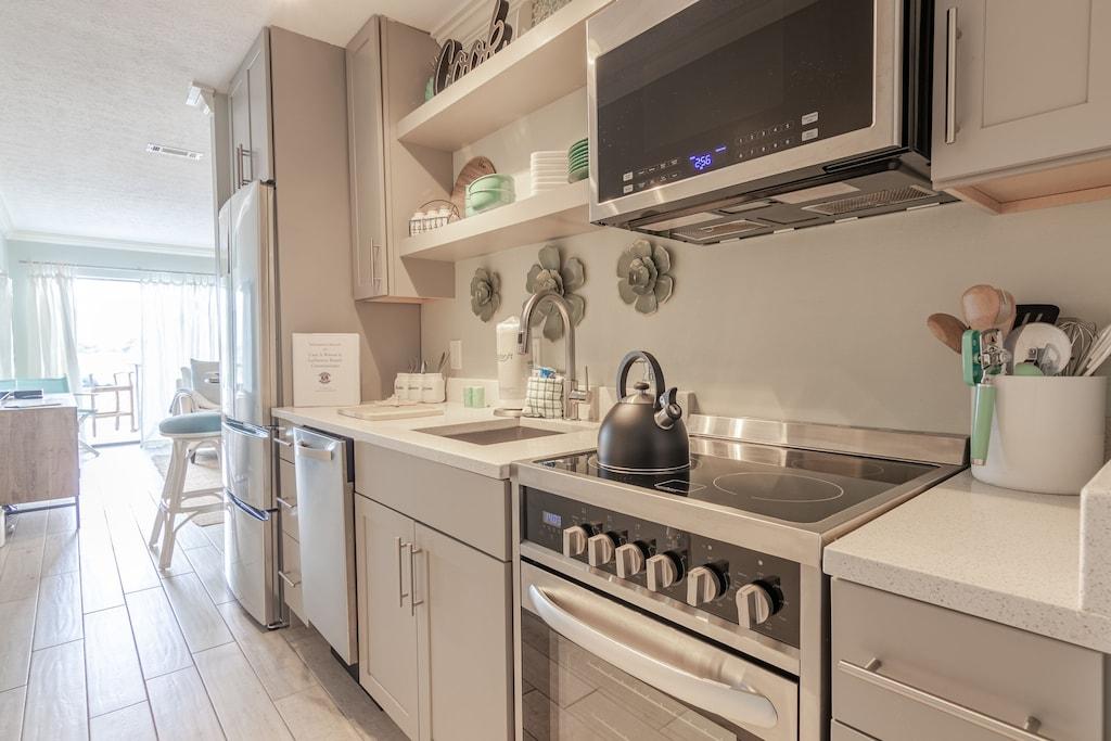 Kitchenette  - dishwasher, stove, microwave & fridge.