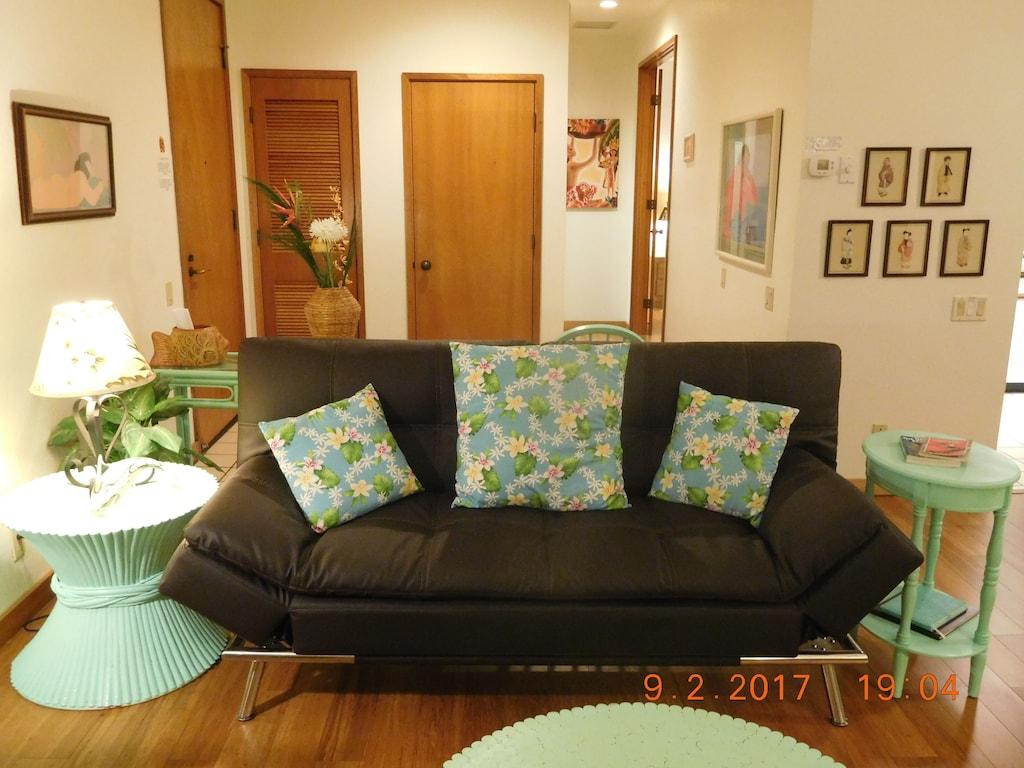living area looking toward hallway, bath and bedroom