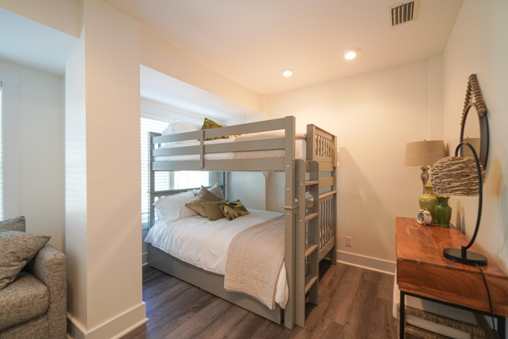 Bunk room with desk space and sleeper sofa