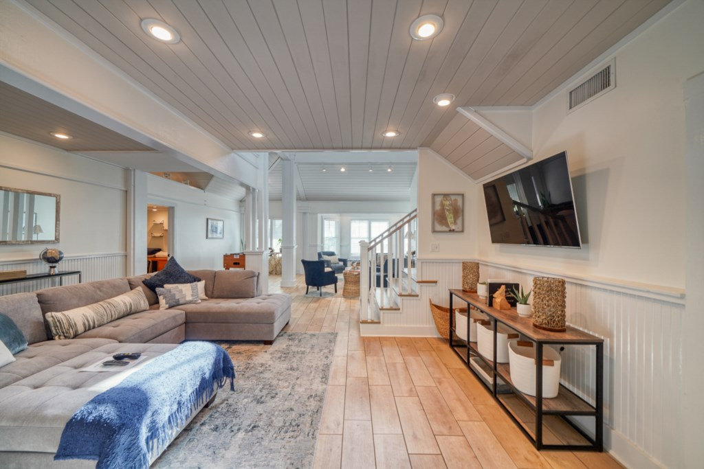 Two designated living areas with plenty of space to relax and unwind