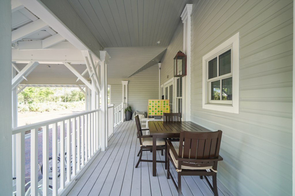 Large covered patio with ample seating and options for outdoor living