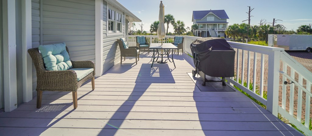 Partial water views offered from the large deck with alfresco dining options and propane grill