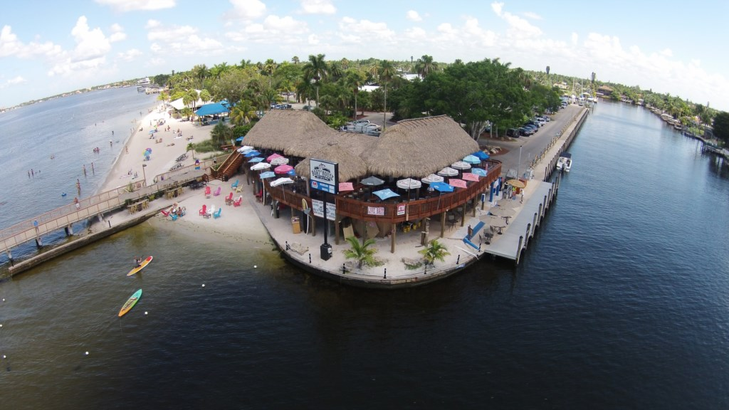 The Tiki Bar and Grill in the Yacht Club with public beach