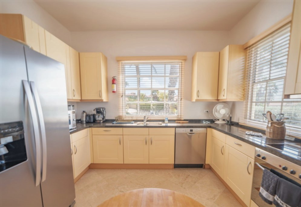 Large fully equipped kitchen with view to dining and living area