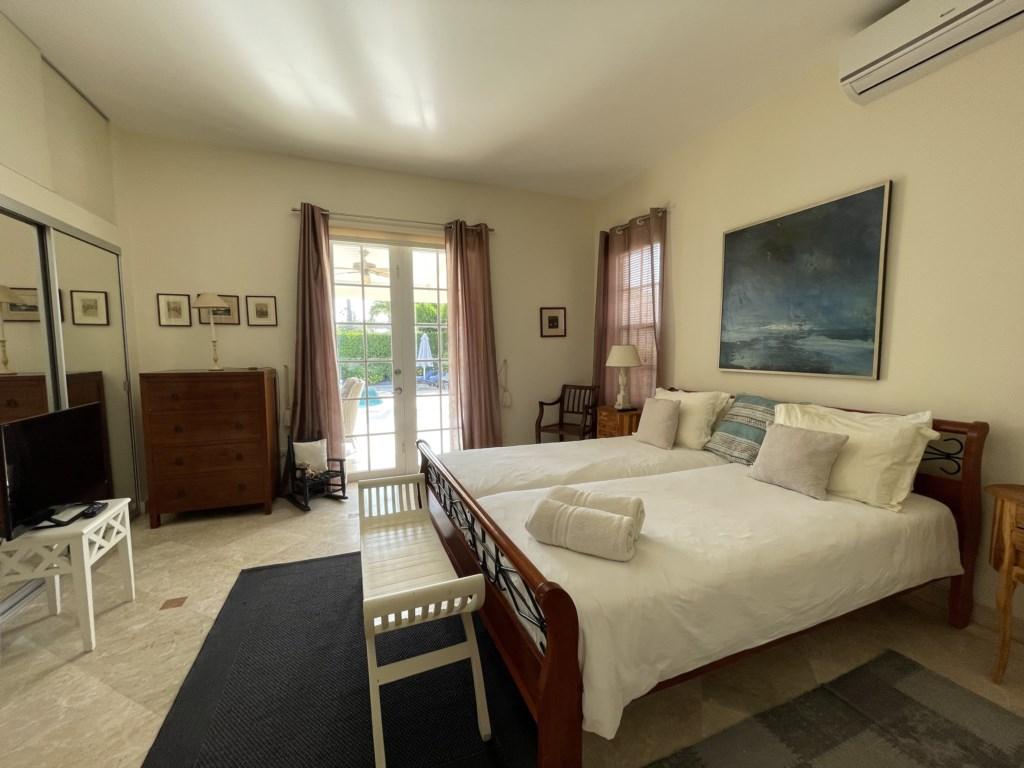 Master Bedroom with TV and En Suite Bathroom