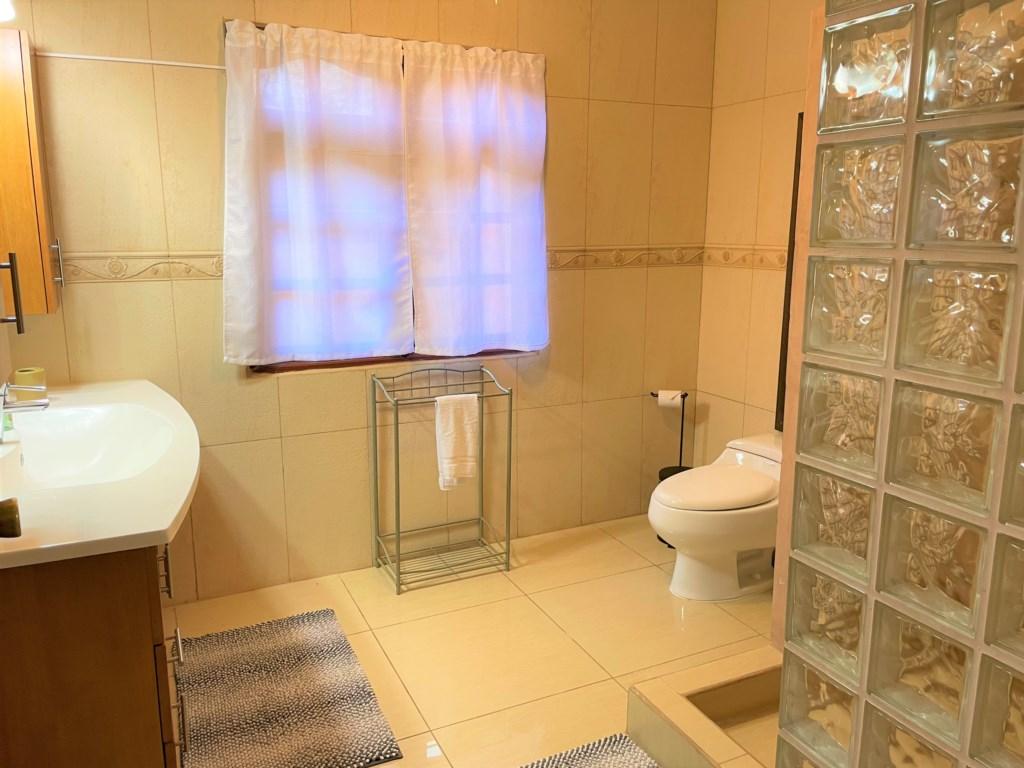 Bathroom with hot water, hair dryer, ceiling fan