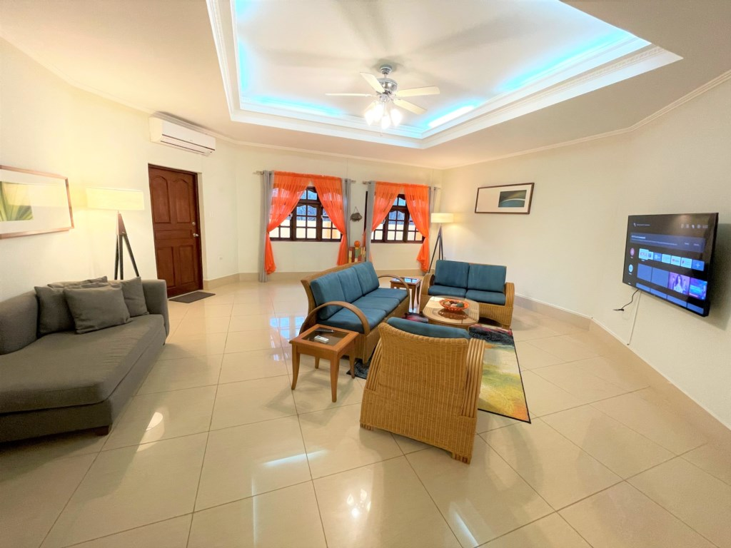 Large and confortable living room with big smart tv