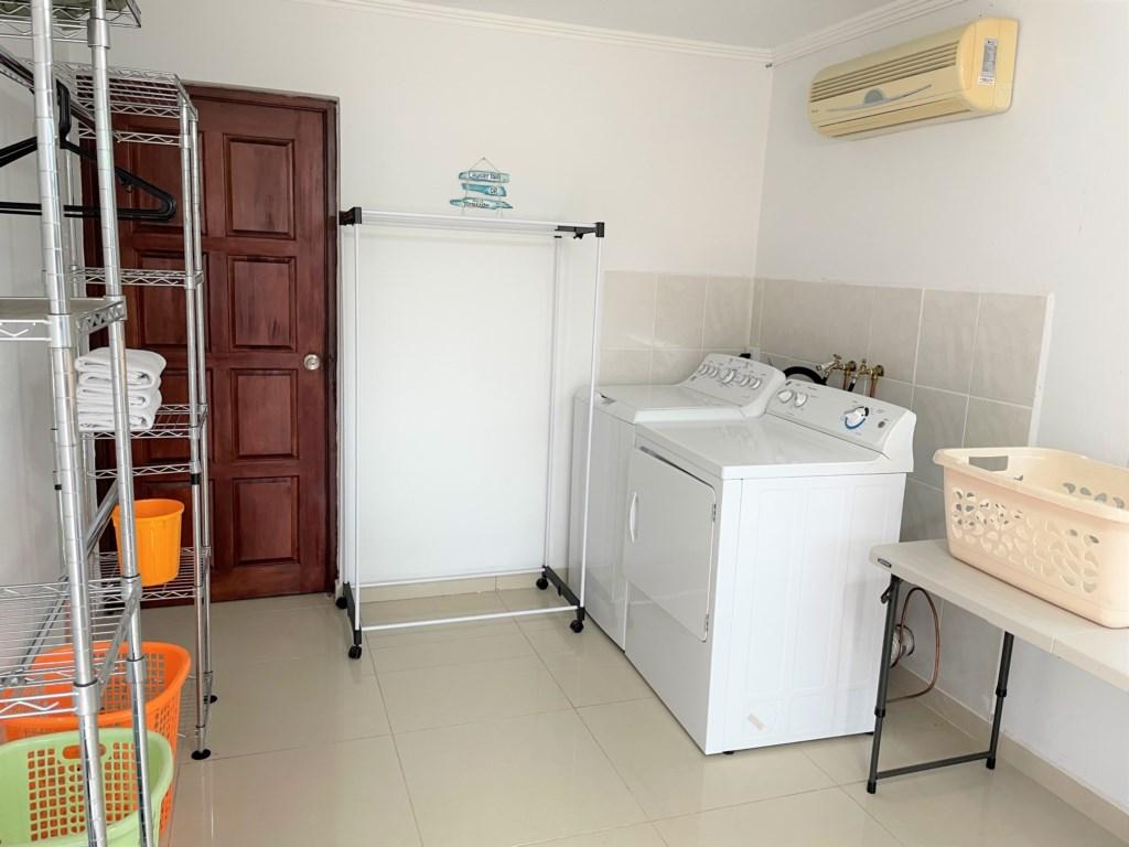 Laundry, outsite bathroom, washing machine and dryer