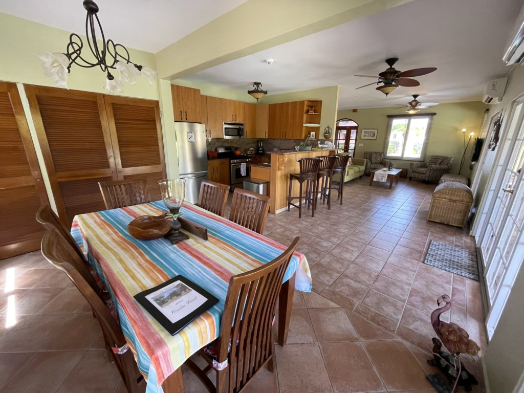 Cozy dining room with table for 6, enclosed Laundry