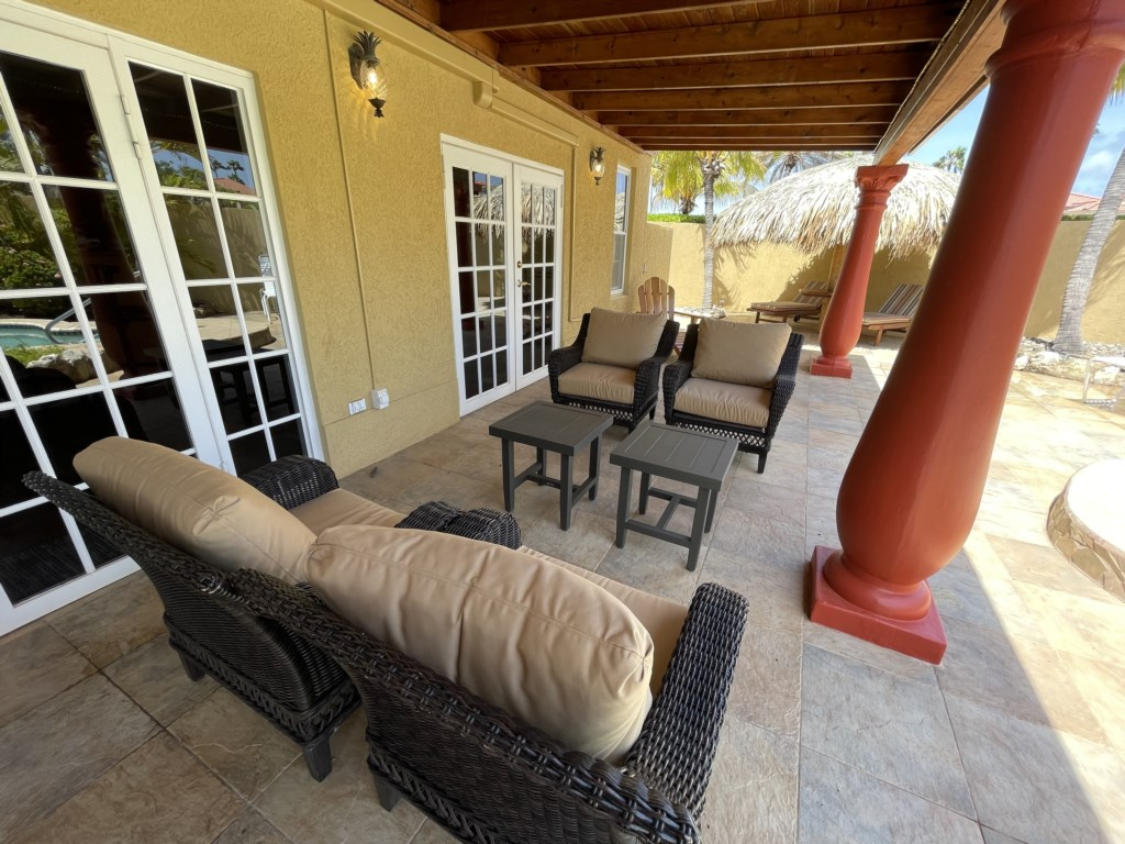 Relaxing porch, shaded seating area with gas grill