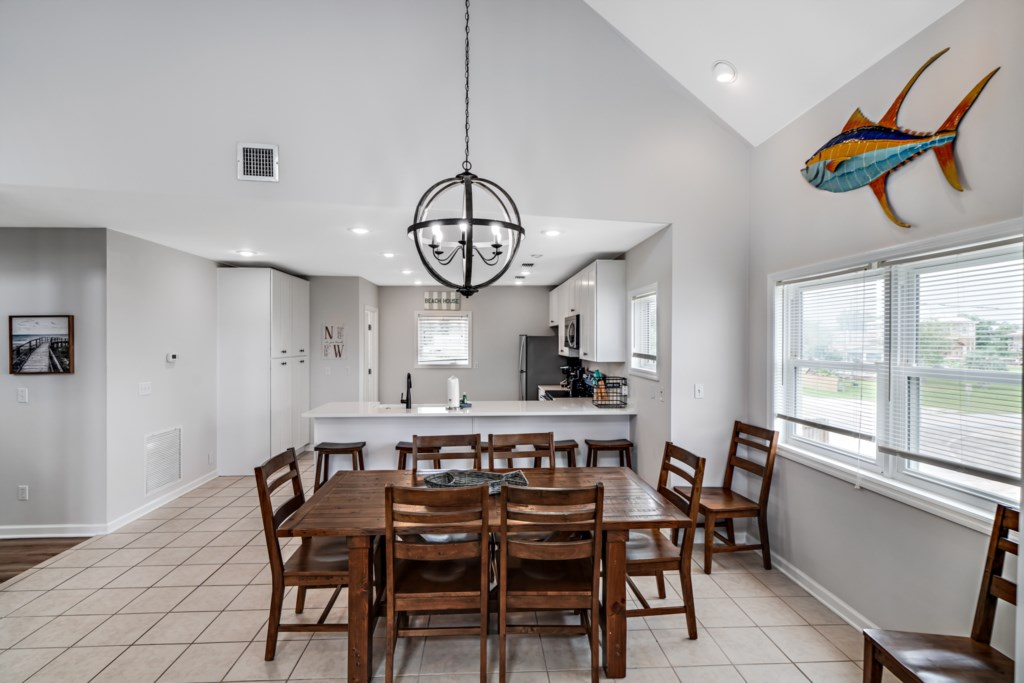 Beautiful natural light surrounds the dining room table