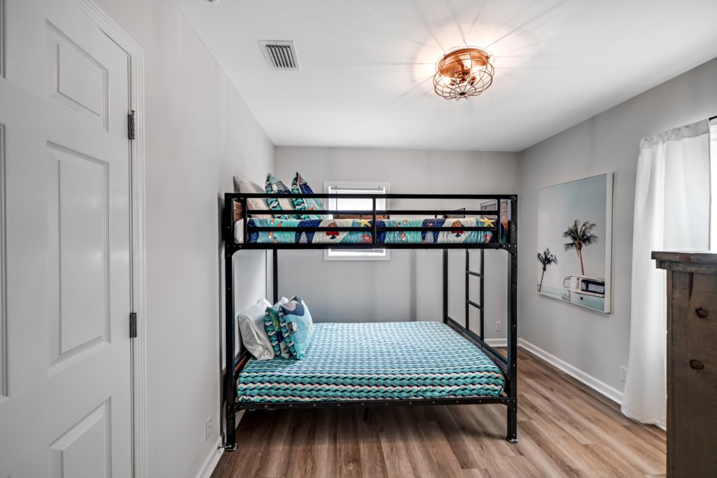 Bunk room with queen beds and flat screen television