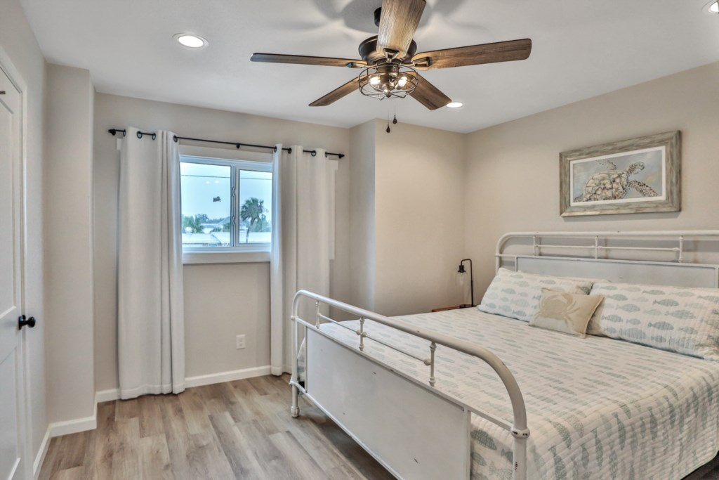 King guest bedroom with attached half bath