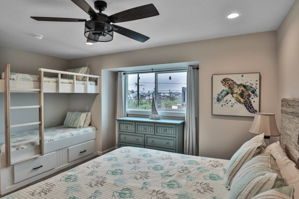 king bedroom with 2 twin bunks