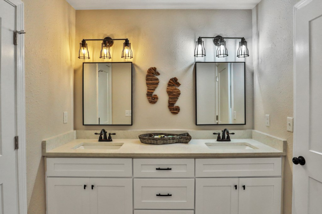 attached bathroom with double vanity and large closet